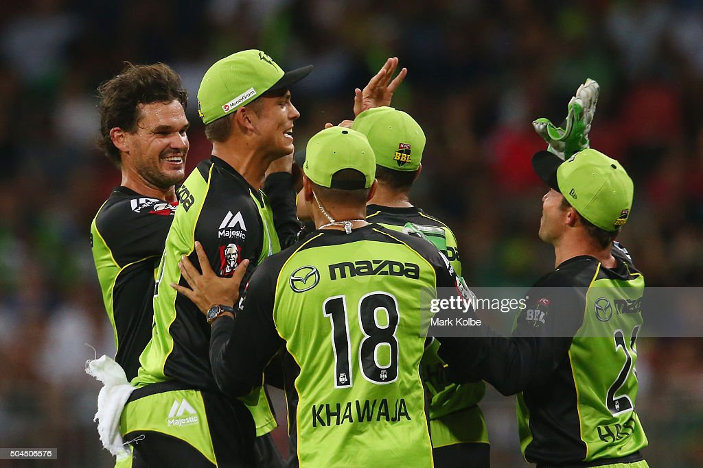 Clint McKay of the Thunder celebrates with his team after taking the wicket of Chris Gayle of the Renegadesduring the Big Bash League match between the Sydney Thunder and the Melbourne Renegades at Spotless Stadium on January 11, 2016 in Sydney, Australia.