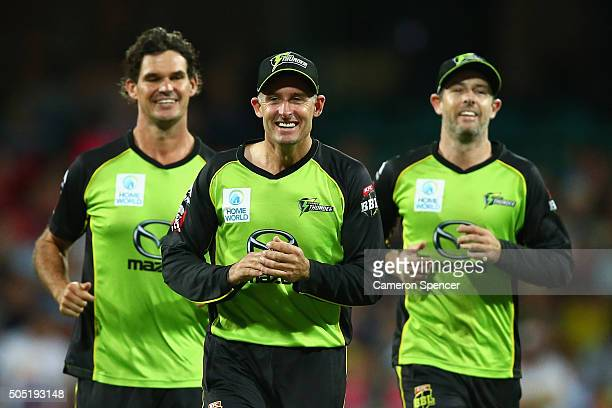 Clint McKay Thunder captain Michael Husssey and Ben Rohrer of the Thunder smile after the dismissal of Jackson Bird of the Sixers during the Big Bash...