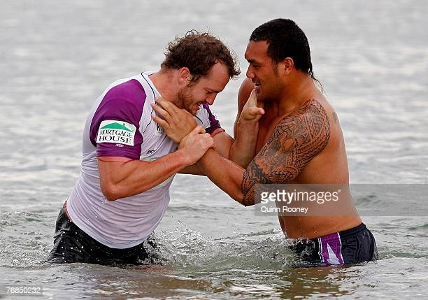 Clint Newton and Jeff Lima of the Storm have a wrestle during a Melbourne Storm recovery session held at St Kilda beach on September 19 2007 in...