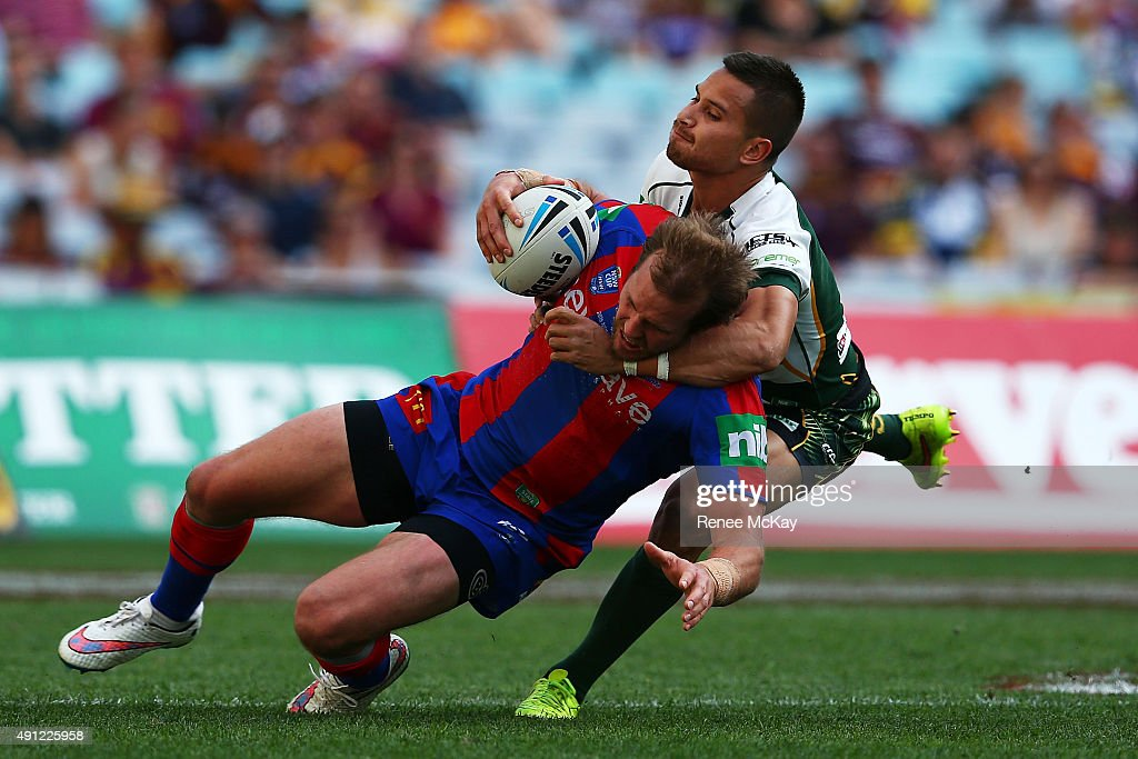Clint Newton of the Knights is tackled during the 2015 State Championship Grand Final match between Ipswich Jets and the Newcastle Knights at ANZ Stadium on October 4, 2015 in Sydney, Australia.