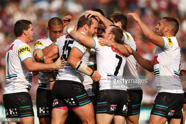 Clint Newton of the Panthers celebrates with team mates after scoring a try during the round 26 NRL match between the Manly Warringah Sea Eagles and...