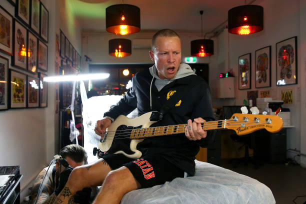AUS: Punk Band The Dead Love Perform While Being Tattooed In Sydney