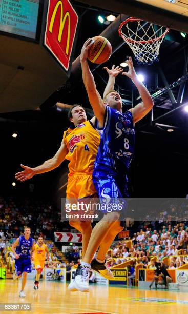 Clint Reed of the Spirit makes a layup despite the defence of Kelvin Robertson of the Crocodiles during the round six NBL match between the...