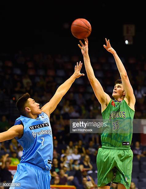 Clint Steindl of the Crocodiles takes a shot over Reuben Te Rangi of the Breakers during the round nine NBL match between the Townsville Crocodiles...