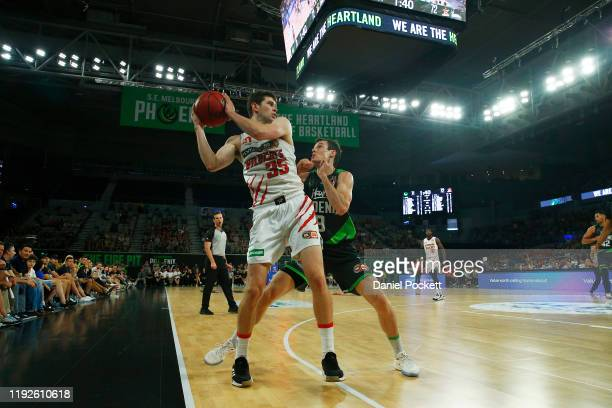 Clint Steindl of the Wildcats and Ben Madgen of the Phoenix contest the ball during the round 10 NBL match between the South East Melbourne Phoenix...