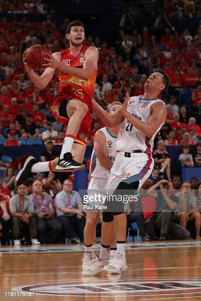 Clint Steindl of the Wildcats lays up against Daniel Johnson of the 36ers during the round nine NBL match between the Perth Wildcats and the Adelaide...
