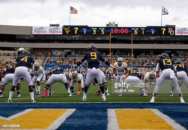 Clint Trickett of the West Virginia Mountaineers directs the offense in the first half against the Baylor Bears during the game on October 18 2014 at...