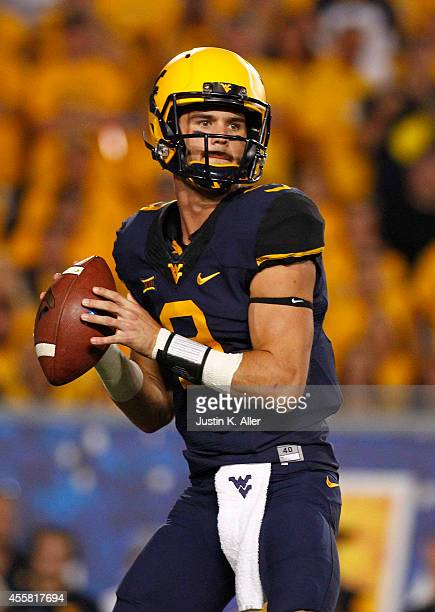 Clint Trickett of the West Virginia Mountaineers drops back to pass in the first half during the game against the Oklahoma Sooners on September 20...