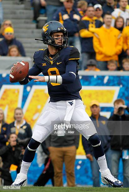 Clint Trickett of the West Virginia Mountaineers drops back to pass against the Baylor Bears during the game on October 18 2014 at Mountaineer Field...