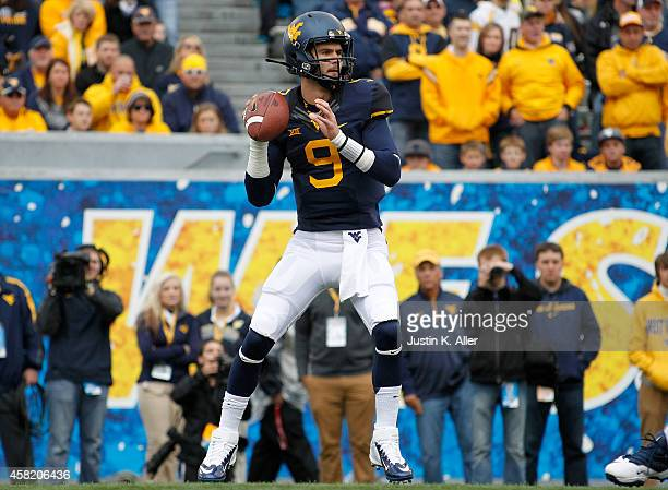 Clint Trickett of the West Virginia Mountaineers drops back to pass during the game against the Baylor Bears on October 18 2014 at Mountaineer Field...