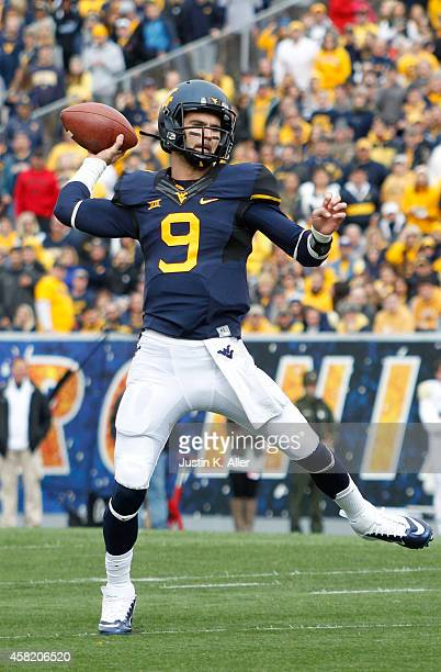 Clint Trickett of the West Virginia Mountaineers rolls out to pass during the game against the Baylor Bears on October 18 2014 at Mountaineer Field...