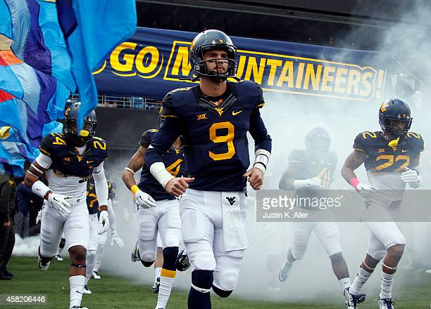 Clint Trickett of the West Virginia Mountaineers runs onto the field before the game against the Baylor Bears on October 18 2014 at Mountaineer Field...