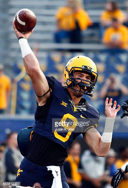 Clint Trickett of the West Virginia Mountaineers warms up before the game against the Oklahoma Sooners on September 20 2014 at Mountaineer Field in...