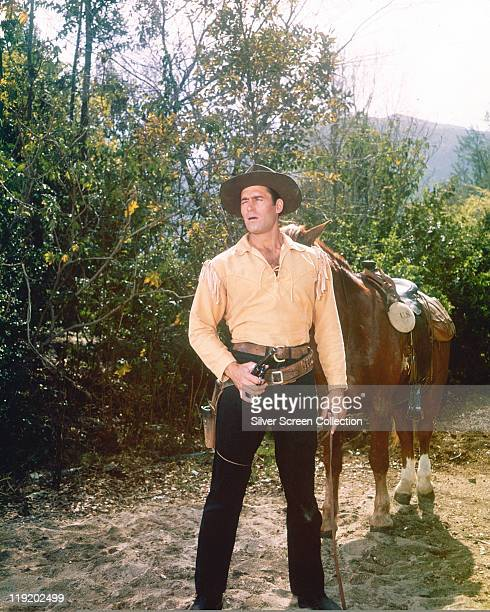 Clint Walker US actor in costume as he stands beside his horse in a publicity portrait issued for the television series 'Cheyenne' USA circa 1960 The...