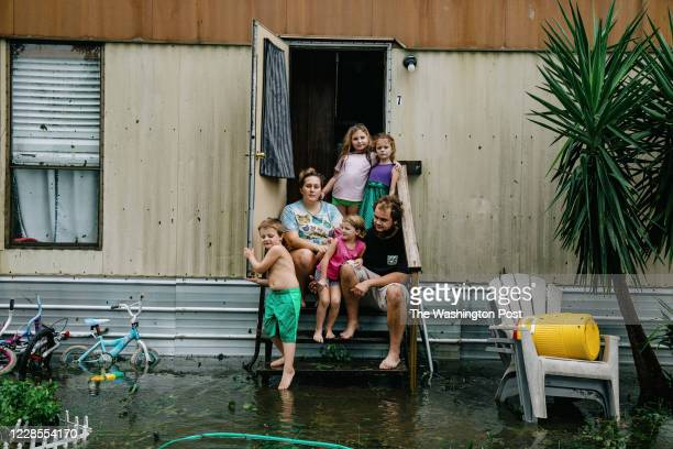 Clinton and Randal Ream with their son Saylor and daughter Nayvie and two neighbors Aubrey Miller and Harmony Morgan at their home in a small trailer...