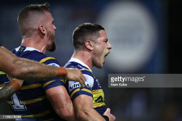 Clinton Gutherson and Mitchell Moses of the Eels celebrate Moses scoring a try during the round 15 NRL match between the Parramatta Eels and the...