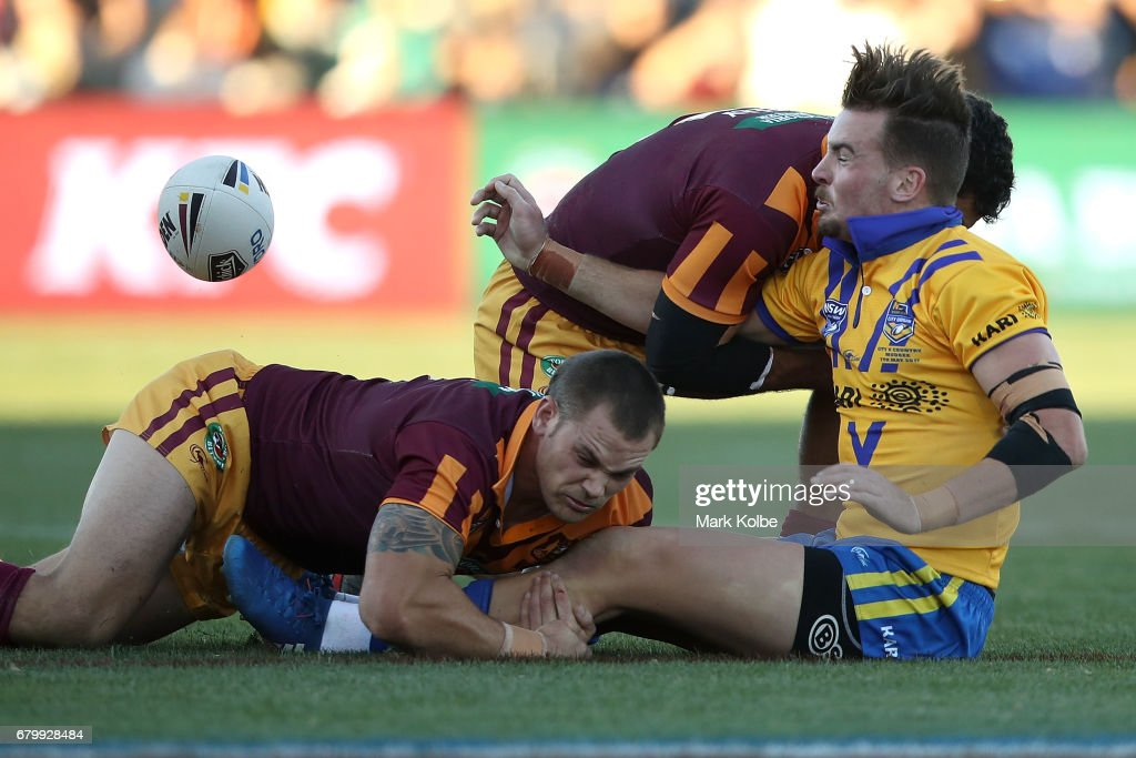 Clinton Gutherson of City passes as he is tackled during the 2017 City versus Country Origin match at Glen Willow Sports Ground on May 7, 2017 in Mudgee, Australia.