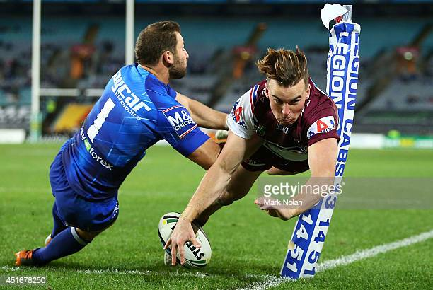 Clinton Gutherson of the Eagles dives to score a try during the round 17 NRL match between the Canterbury Bulldogs and the Manly Sea Eagles at ANZ...