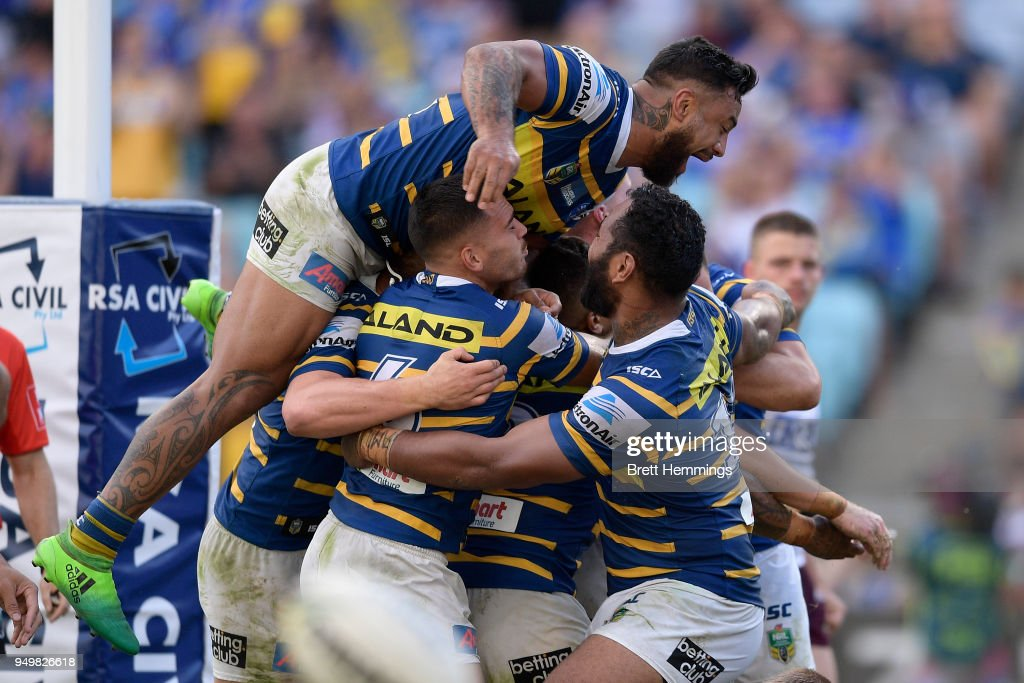 Clinton Gutherson of the Eels celebrates scoring a try with team mates during the round seven NRL match between the Parramatta Eels and the Manly Sea Eagles at ANZ Stadium on April 22, 2018 in Sydney, Australia.