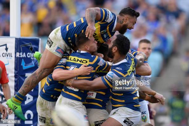 Clinton Gutherson of the Eels celebrates scoring a try with team mates during the round seven NRL match between the Parramatta Eels and the Manly Sea...