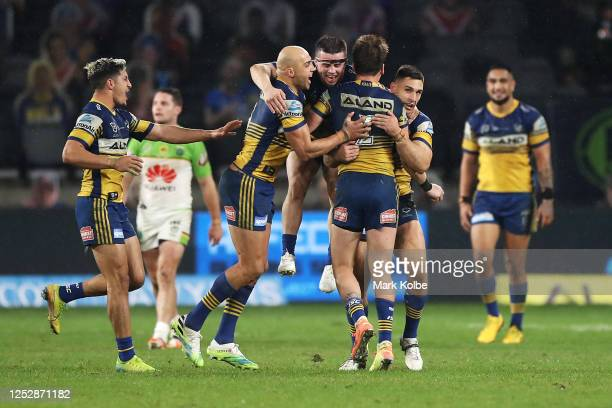 Clinton Gutherson of the Eels celebrates with his team mates after kicking the winning field goal in golden point time during the round seven NRL...