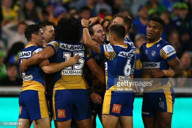 Clinton Gutherson of the Eels celebrates with team mates after scoring a try during the round six NRL match between the Canberra Raiders and the...