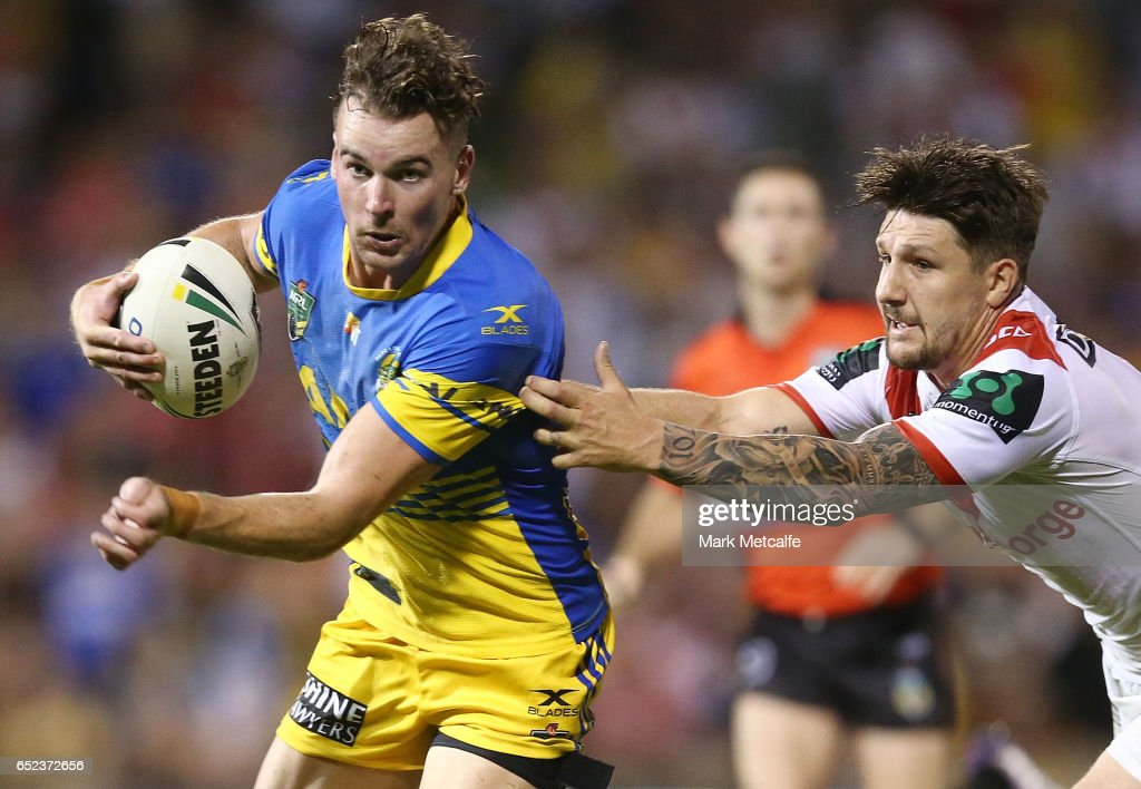 Clinton Gutherson of the Eels is tackled by Gareth Widdop of the Dragons during the round two NRL match between the St George Illawarra Dragons and the Parramatta Eels at WIN Stadium on March 12, 2017 in Wollongong, Australia.