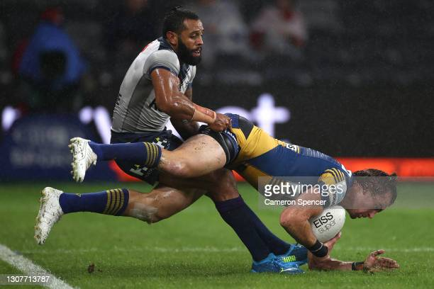 Clinton Gutherson of the Eels is tackled by Josh Addo-Carr of the Storm during the round two NRL match between the Parramatta Eels and the Melbourne...