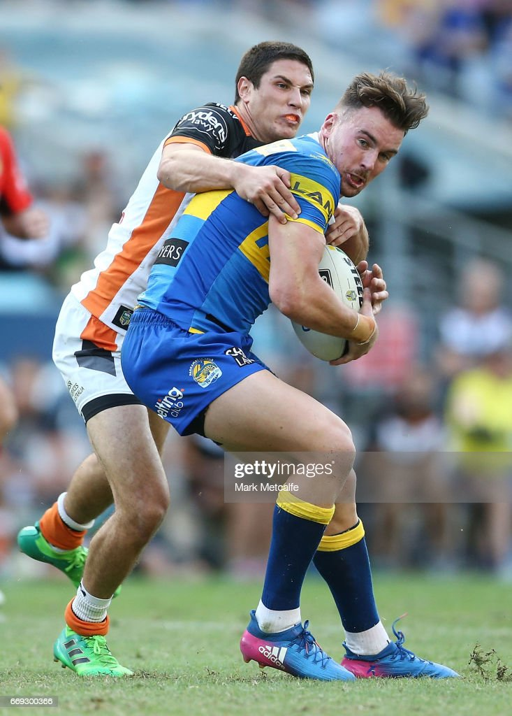 Clinton Gutherson of the Eels is tackled by Mitch Moses of the Tigers during the round seven NRL match between the Parramatta Eels and the Wests Tigers at ANZ Stadium on April 17, 2017 in Sydney, Australia.