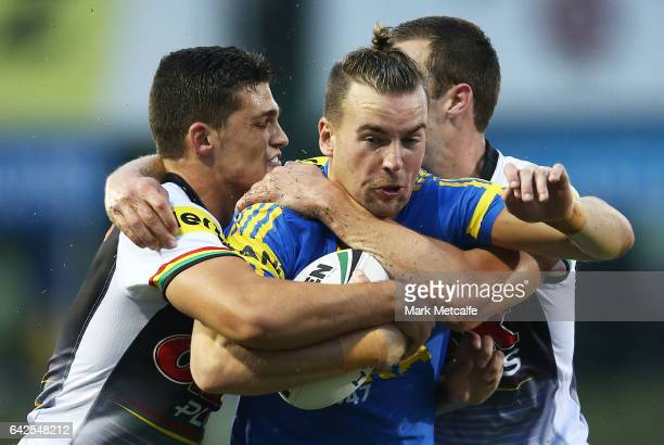 Clinton Gutherson of the Eels is tackled during the NRL Trial match between the Penrith Panthers and Parramatta Eels at Pepper Stadium on February 18...
