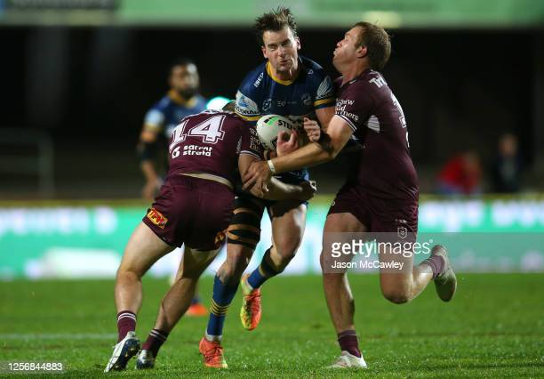 Clinton Gutherson of the Eels is tackled during the round 10 NRL match between the Manly Sea Eagles and the Parramatta Eels at Lottoland on July 18,...