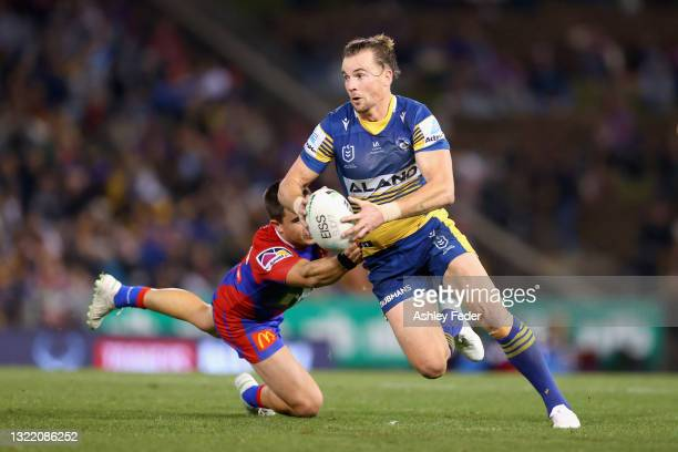 Clinton Gutherson of the Eels is tackled during the round 13 NRL match between the Newcastle Knights and the Parramatta Eels at McDonald Jones...