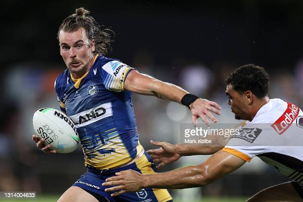 Clinton Gutherson of the Eels is tackled during the round seven NRL match between the Parramatta Eels and the Brisbane Broncos at TIO Stadium on...