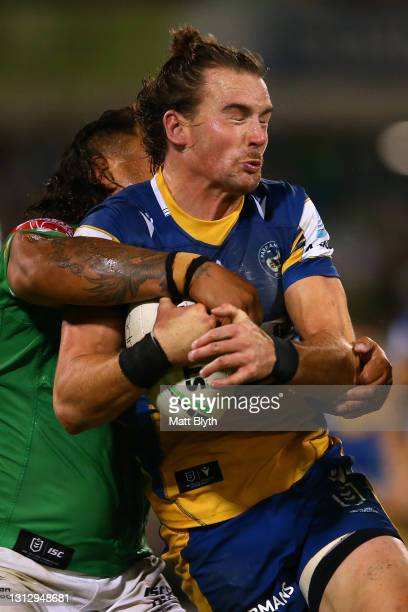 Clinton Gutherson of the Eels is tackled during the round six NRL match between the Canberra Raiders and the Parramatta Eels at GIO Stadium on April...