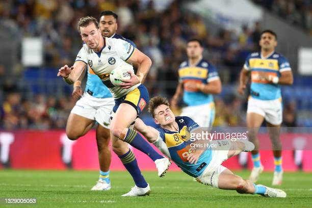 Clinton Gutherson of the Eels makes a break during the round 18 NRL match between the Gold Coast Titans and the Parramatta Eels at Cbus Super...