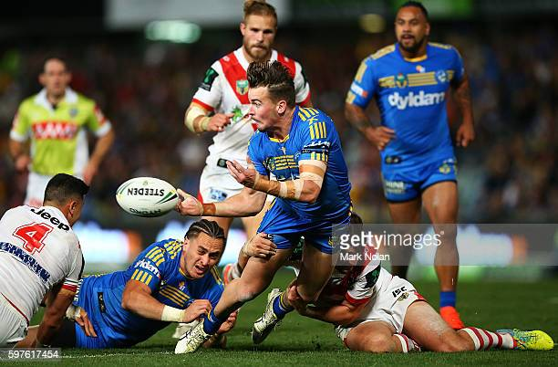 Clinton Gutherson of the Eels offloads during the round 25 NRL match between the Parramatta Eels and the St George Illawarra Dragons at Pirtek...