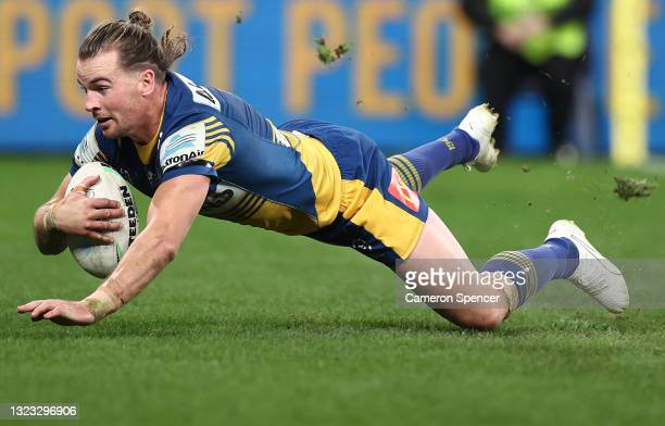 Clinton Gutherson of the Eels scores a try during the round 14 NRL match between the Parramatta Eels and the Wests Tigers at Bankwest Stadium, on...