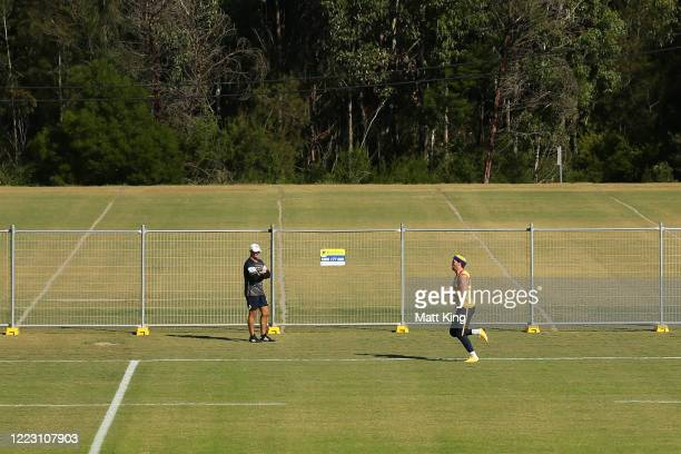 Clinton Gutherson runs as Eels head coach Brad Arthur looks on during a Parramatta Eels NRL training session at Kellyville Park on May 06, 2020 in...