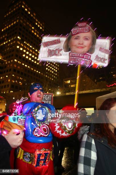 Clinton Jessee from Seattle joins hundreds of people who turned out for a rally at Westlake Center on March 8 2017 in Seattle Washington The rally...