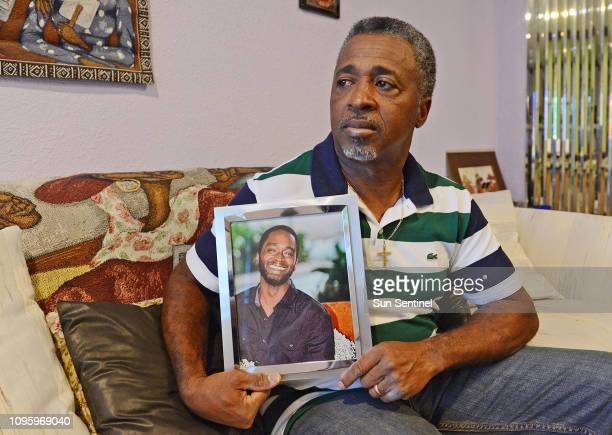 Clinton Jones holds a portrait of his late son Corey Jones who was shot and killed by Officer Nouman Raja in Pompano Beach Fla in January 2017