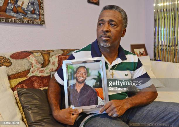 Clinton Jones holds a portrait of his late son Corey Jones who was shot and killed by Officer Nouman Raja in Pompano Beach Fla in January 2017 A...