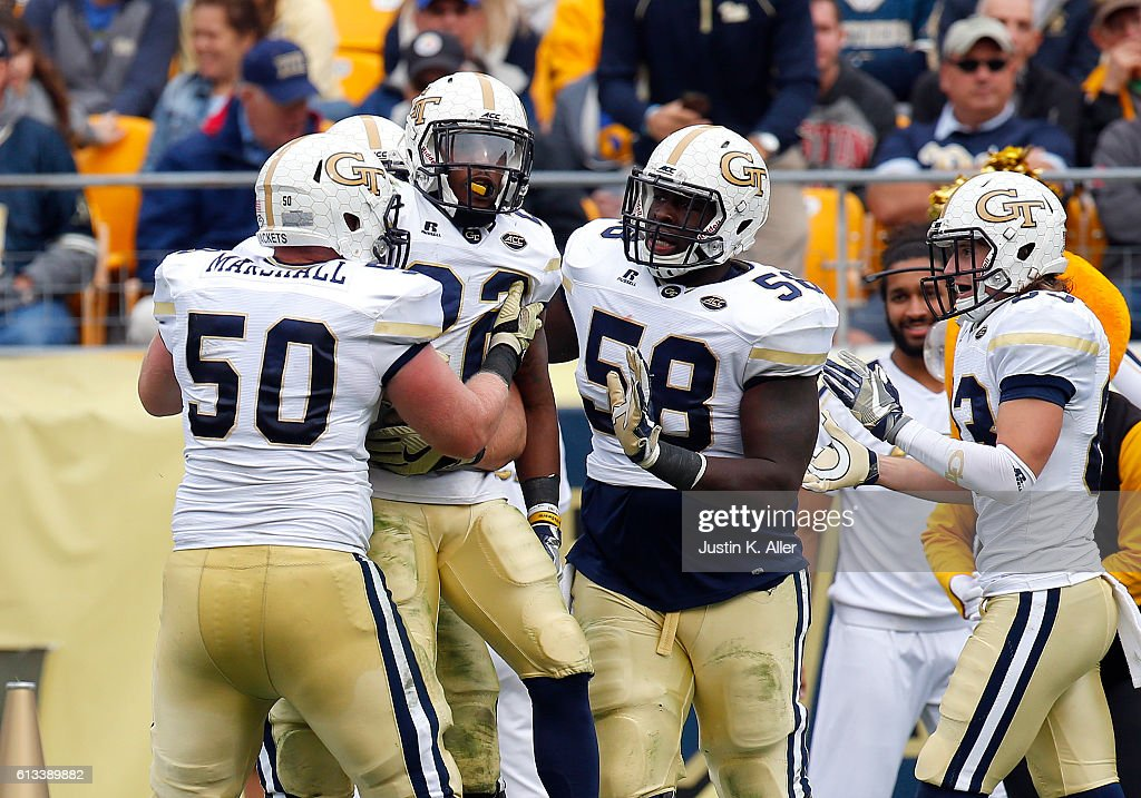 Clinton Lynch #22 of the Georgia Tech Yellow Jackets celebrates after rushing for a 45 yard touchdown in the second half during the game against the Pittsburgh Panthers on October 8, 2016 at Heinz Field in Pittsburgh, Pennsylvania.