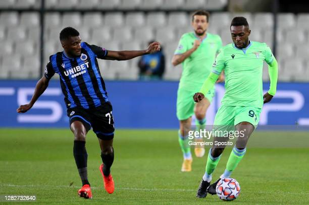 Clinton Mata of Club Bregge KV compete for the ball with Juan Daniel Akpa Akproof SS Lazio during the UEFA Champions League Group F stage match...