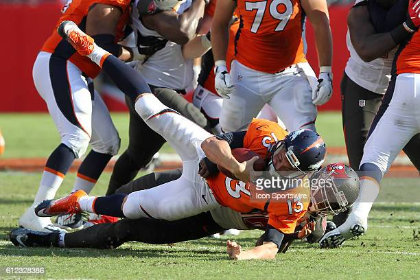 Clinton McDonald of the Buccaneers sacks Broncos quarterback Trevor Siemien during the regular season game between the Denver Broncos and the Tampa...
