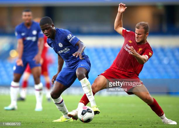 Clinton Mola of Chelsea is tackled by Herbie Kane during the Premier League 2 match between Chelsea and Liverpool at Stamford Bridge on August 19...