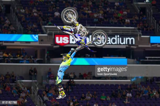 Clinton Moore dangles from his dirtbike during Moto X Freestyle at X Games Minneapolis on July 14 2017 at US Bank Stadium in Minneapolis Minnesota