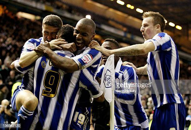 Clinton Morrison celebrates with goal scorer Chris O'Grady of Sheffield Wednesday after scoring the opening goal during the FA Cup Third Round match...
