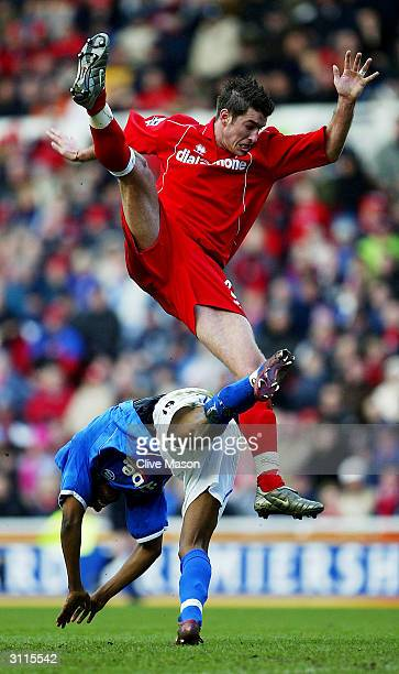 Clinton Morrison of Birmingham City is tackled by Franck Queudrue of Middlesbrough during the FA Barclaycard Premiership match between Middlesbrough...