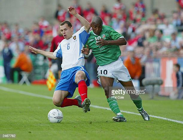 Clinton Morrison of Ireland gets tackled by Sergy Ignashevich of Russia during the Euro 2004 Qualifierying Match between Ireland and Russia at...