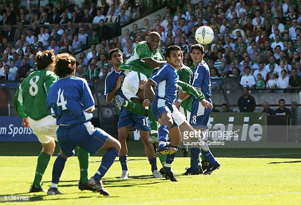 Clinton Morrison of Ireland rises above the the Cyprus defence to score the opening goal during The World Cup 2006 Group Four Qualifier match between...